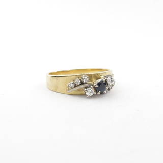 18ct yellow and white gold sapphire and diamond set ring
