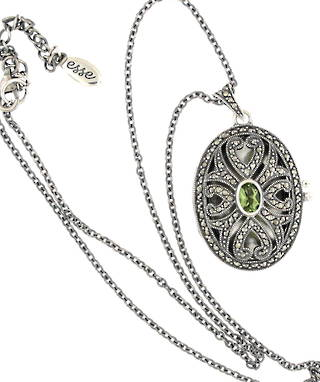 Brand new sterling silver marcasite and peridot locket and chain