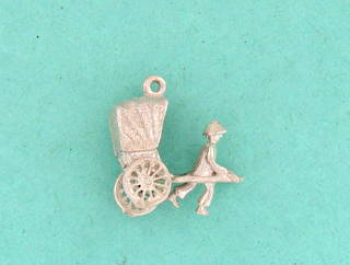 Sterling silver 'man pulling carriage' charm