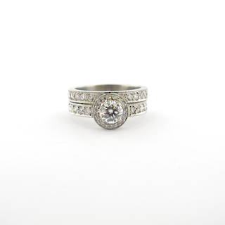 Platinum diamond cluster ring and platinum diamond wedding band set