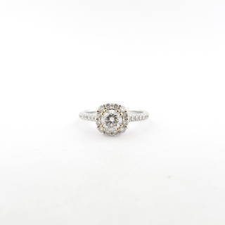 18ct while gold diamond set halo solitaire ring with shoulder diamonds