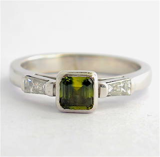 18ct white gold green sapphire and baguette diamond ring