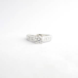 18ct white gold diamond solitaire ring with princess cut shoulder diamonds