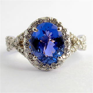 14ct white gold tanzanite and diamond split shank halo style ring