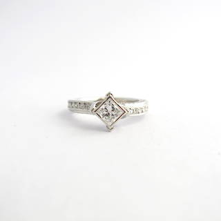 Platinum diamond solitaire crossover style ring