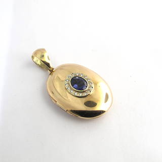 9ct yellow gold iolite and diamond oval locket