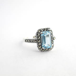 Brand new Sterling silver emerald cut blue topaz and marcasite ring