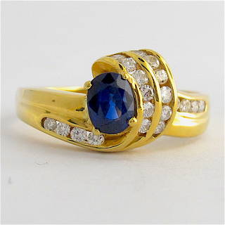 18ct yellow gold diamond and sapphire set fancy ring
