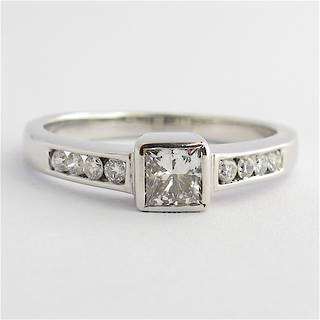 14ct white gold princess cut diamond solitaire ring with shoulder diamonds