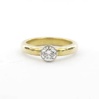 18ct yellow gold and platinum diamond solitaire rub over set ring