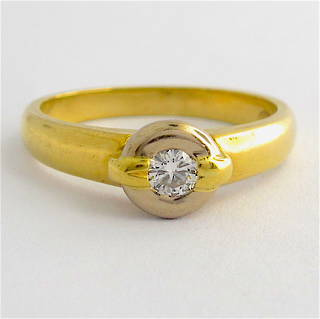 18ct yellow and white gold rub over set diamond ring