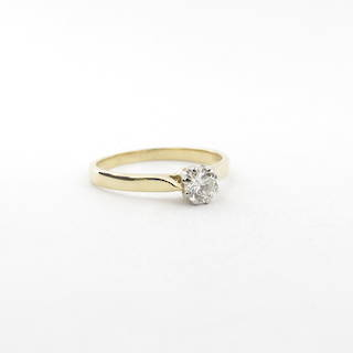 18ct yellow gold and palladium solitaire ring