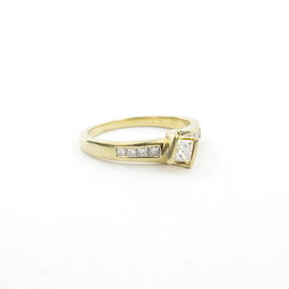 18ct yellow and white gold princess cut diamond solitaire ring with shoulder diamonds
