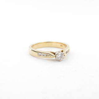 18ct yellow and white gold diamond solitaire with shoulder diamond set ring