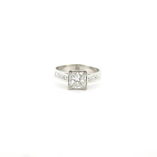 Platinum and diamond solitaire ring with shoulder diamonds