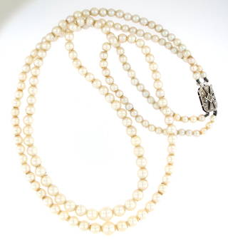 Graduated cultured double strande pearl necklace with diamond 9ct white gold clasp