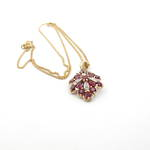 9ct yellow gold synthetic ruby and diamond set pendant with plated curb chain