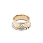 18ct rose and white gold band set with 1 diamond