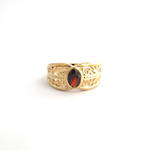 9ct yellow gold filigree style garnet ring