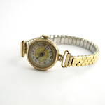 Women's yellow gold watch with 9ct case and stretchy strap