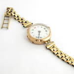 Women's yellow & rose gold watch with a 9ct case and bracelet