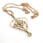 9ct rose gold antique peridot pendant with a 9ct round belcher link chain