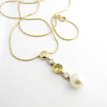 22ct & 18ct yellow gold and 18ct white gold South Sea white pearl,  yellow sapphire and diamond pendant