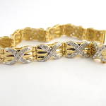 18ct yellow & rhodium plated diamond criss-cross style bracelet