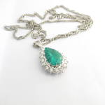 Platinum 7.33ct emerald and diamond cluster style pendant with platinum chain