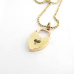 15ct yellow over rose gold vintage heart pendant set with diamond, ruby and sapphire on a yellow gold chain