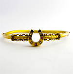 15ct yellow over rose gold antique horseshoe hinged bangle set with rubies and rose cut diamonds