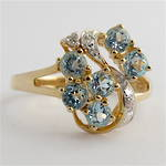 9ct yellow and white gold blue topaz and diamond set cluster ring
