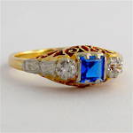 18ct yellow gold/platinum zircon and synthetic sapphire set dress ring