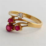 14ct yellow gold ruby and diamond set dress ring