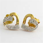 9ct yellow gold and rhodium plated heart shape diamond stud earrings