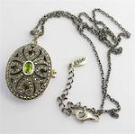 Sterling silver marcasite and peridot locket and chain