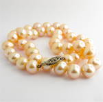 Coral/pink freshwater pearl necklace with sterling silver clasp
