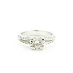 18ct white gold diamond solitaire diamond ring with split shank diamond set shoulders