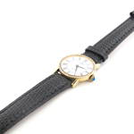 Baume and Mercier diamond watch with 18ct yellow gold case and  black leather strap