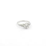 Platinum diamond solitaire ring with shoulder diamonds