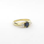 Lady's 18ct yellow gold sapphire and two diamond set ring