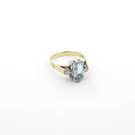 18ct yellow/white gold aquamarine and three stone diamond ring
